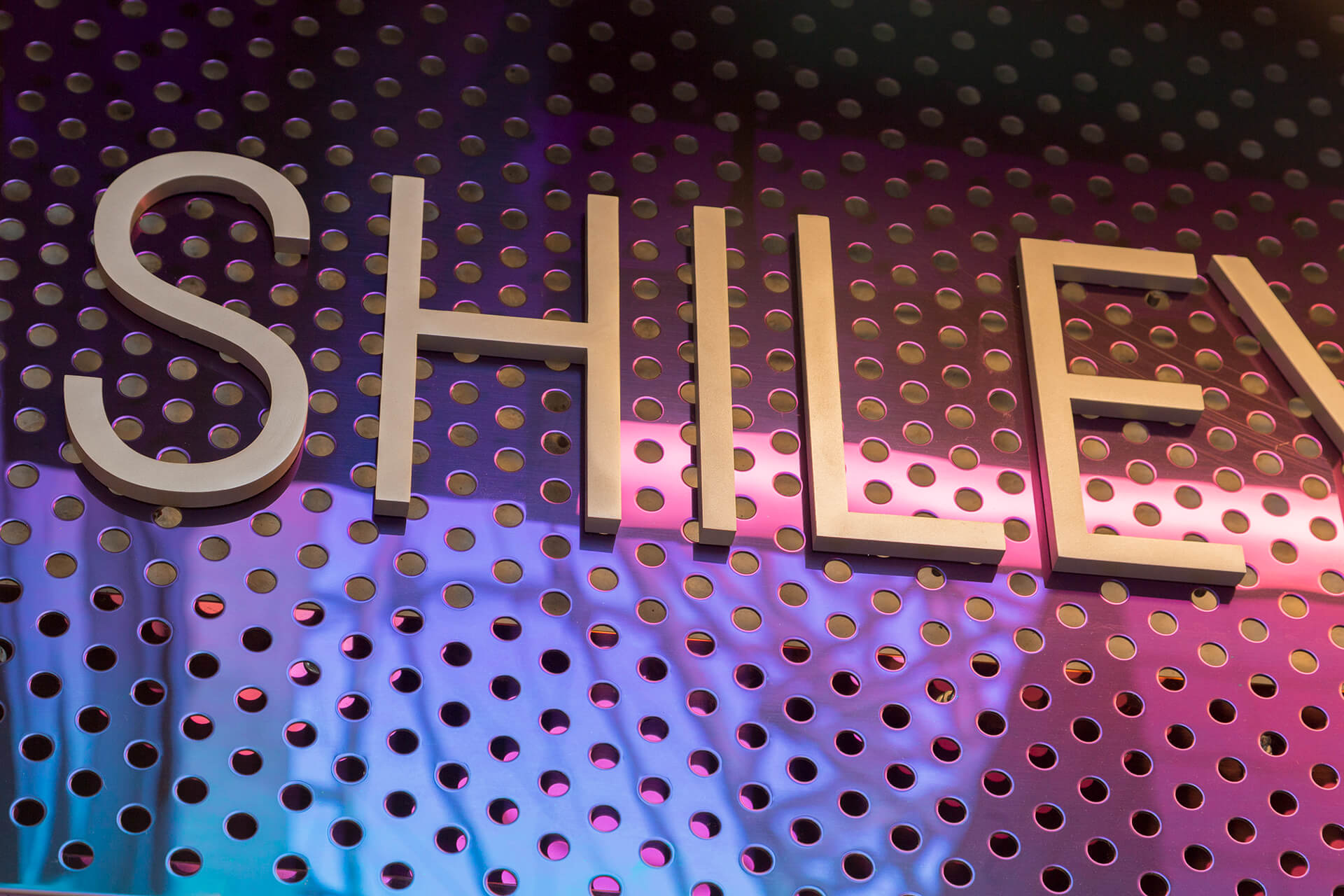 Shiley Special Events Suite, signage and decorative perforated cladding in interference stainless steel.